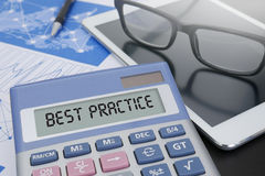 BEST PRACTICE CONCEPT. Calculator  on table with Office Supplies. ipad Stock Image