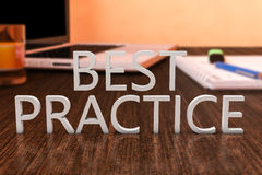 Best Practice. Letters on wooden desk with laptop computer and a notebook. 3d render illustration Royalty Free Stock Images