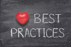Best practices heart. Best practices phrase written on chalkboard with red heart symbol royalty free stock photo