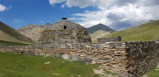 Back side of Tash-rabat, fortress in Naryn oblast, Kyrgyzstan stock images