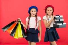Best price. Buy now. Visit shopping mall. Kids girls hold bunch shopping bags or birthday gifts packages. Dreams come. True. Happy childhood. Shopping concept royalty free stock photos
