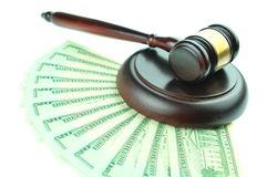 Best price. Detail of gavel and American dollars isolated on white royalty free stock image