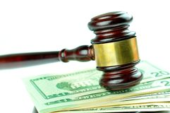 Best price. Detail of gavel and American dollars isolated on white Royalty Free Stock Photos