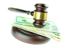 Best price. Detail of gavel and American dollars isolated on white Stock Image