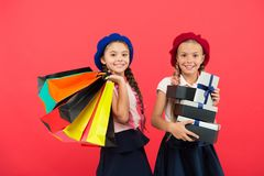 Best price. Visit shopping mall. Kids girls hold bunch shopping bags or birthday gifts packages. Dreams come true. Happy. Childhood. Shopping concept. Child stock photos