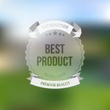 Best product sticker isolated on blurred Stock Image