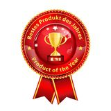 Best product of the Year - award ribbon with text in English and German. Best product of the Year - red and golden award badge with text in English and German Stock Photography