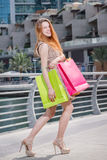 Best purchase. Young girl holding shopping bags and looking in s Stock Image