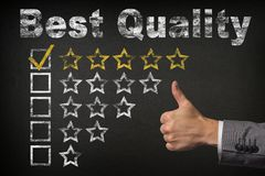 Best Quality five 5 star rating. thumbs up service golden rating stars on chalkboard.  stock photo