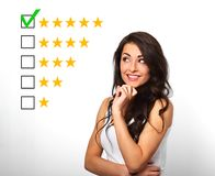 The best rating, evaluation, online rewiew. Business confident h. Appy woman voting to five yellow star to increase ranking isolated on white background Stock Photo