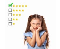 The best rating, evaluation, online rewiew. Business thinking st. Ress kid girl looking up and voting to five yellow star to increase ranking isolated on white royalty free stock image