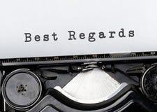Best regards. Vintage inscription on old typewriter stock image