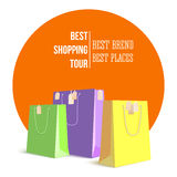 Best shopping tour, advertising banner with paper bags and label from new purchased items on bright orange backdrop Royalty Free Stock Image