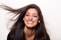 Best smile is a real smile. Portrait of a young  confident woman with long hair posing Royalty Free Stock Photography