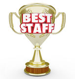 Best Staff Trophy Prize Award Top Workforce Team Employees. Best Staff words in 3d letters on a gold trophy given as an award to the top or highest performing Royalty Free Stock Photos