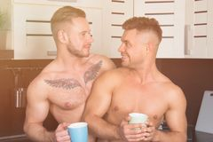 The best start of the day. Two guys in the kitchen stock image