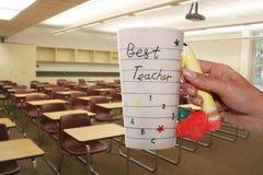 Best Teacher. A woman holding a best teacher mug royalty free stock photos