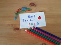 Best Teacher Ever. Sign with colored pencils laying on a wooden background, School supplies, Back to school, Kindergarten and Elementary students royalty free stock photos