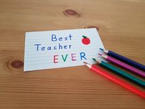 Best Teacher Ever. Sign with colored pencils laying on a wooden background, School supplies, Back to school, Kindergarten and Elementary students stock image
