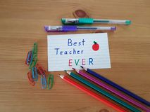 Best Teacher Ever. Sign with colored pencils laying on a wooden background, School supplies, Back to school, Kindergarten and Elementary students stock photography