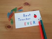 Best Teacher Ever. Sign with colored pencils laying on a wooden background, School supplies, Back to school, Kindergarten and Elementary students stock photo
