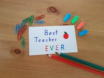 Best Teacher Ever. Sign with colored pencils laying on a wooden background, School supplies, Back to school, Kindergarten and Elementary students stock images