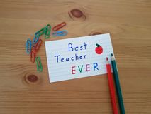 Best Teacher Ever. Sign with colored pencils laying on a wooden background, School supplies, Back to school, Kindergarten and Elementary students royalty free stock images