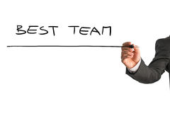 Best team sign. Closeup of male hand writing Best team on virtual screen Royalty Free Stock Photography