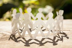 The best teamwork. Concept of business teamwork with paper people chain stock photography