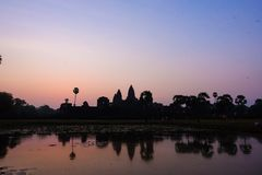 Silhouette Angkor Wat with reflected in lake Siem Reap royalty free stock photos