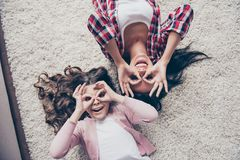 The best time in my life! Top view photo full of fun and laughter. Happy mother wearing checkered shirt and her little daughter royalty free stock images