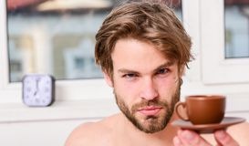 Best time to have your cup of coffee. Every morning with his coffee. Man bearded handsome macho hold cup of coffee. Guy stock photo