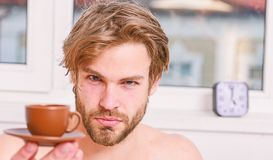 Best time to have your cup of coffee. Every morning with his coffee. Man bearded handsome macho hold cup of coffee. Guy royalty free stock photo