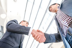 Best top deal! Two young businessman standing opposite each othe Stock Photo