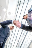 Best top deal! Two young businessman standing opposite each other Royalty Free Stock Photography