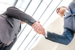 Best top deal! Two young businessman standing opposite each other Stock Photo