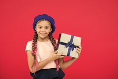 Best toys and christmas gifts. Kid little girl in beret hat hold gift box. Child excited about unpacking gift. Small royalty free stock photo