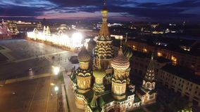 Saint Basil`s Cathedral flight around. Moscow Kremlin and Red Square. Evening embankment road traffic. City illumination. stock video