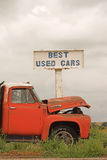 Best Used Cars. Old sign and rusty old vehicle stock photos
