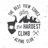 Vintage typography design with ice axe, rock climbing Goat and mountain silhouette. The best view comes after the hardest climb. Alpine club badge. Vintage Royalty Free Stock Images