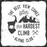 Vintage typography design with ice axe, rock climbing Goat and mountain silhouette. The best view comes after the hardest climb. Alpine club badge. Vintage Stock Image