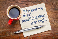 The best way to get something done. Is to begin - inspirational phrase on a napkin with cup of coffee Royalty Free Stock Images