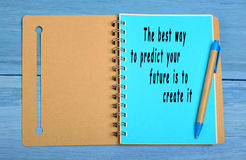 The best way to predict your future is to create it. Written on notebook Stock Photos