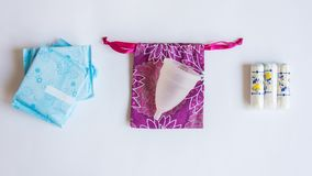 Protection for female hygeine. Set of menstrual cup, gaskets and tampons. royalty free stock photography