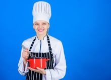 Best whipping techniques. Woman chef hold whisk and pot. Whipping like professional. Girl whipping eggs or cream. Start royalty free stock photos