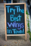 Best Wings. Sidewalk advertisement for local restaurant's chicken wings Stock Image