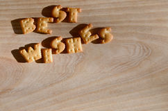 Best wishes. Heap of edible letters Royalty Free Stock Images