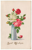 Best Wishes Roses in Vase Vintage Postcard. Antique Best Wishes postcard from the 1900s.  A beautiful bouquet of white, red, yellow and pink roses in a tall vase Royalty Free Stock Photo