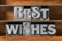 Best wishes tray. Best wishes phrase made from metallic letterpress type on wooden tray stock photography