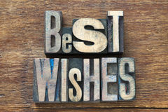Best wishes wood. Best wishes phrase made from wooden letterpress type on grunge wood Royalty Free Stock Photos